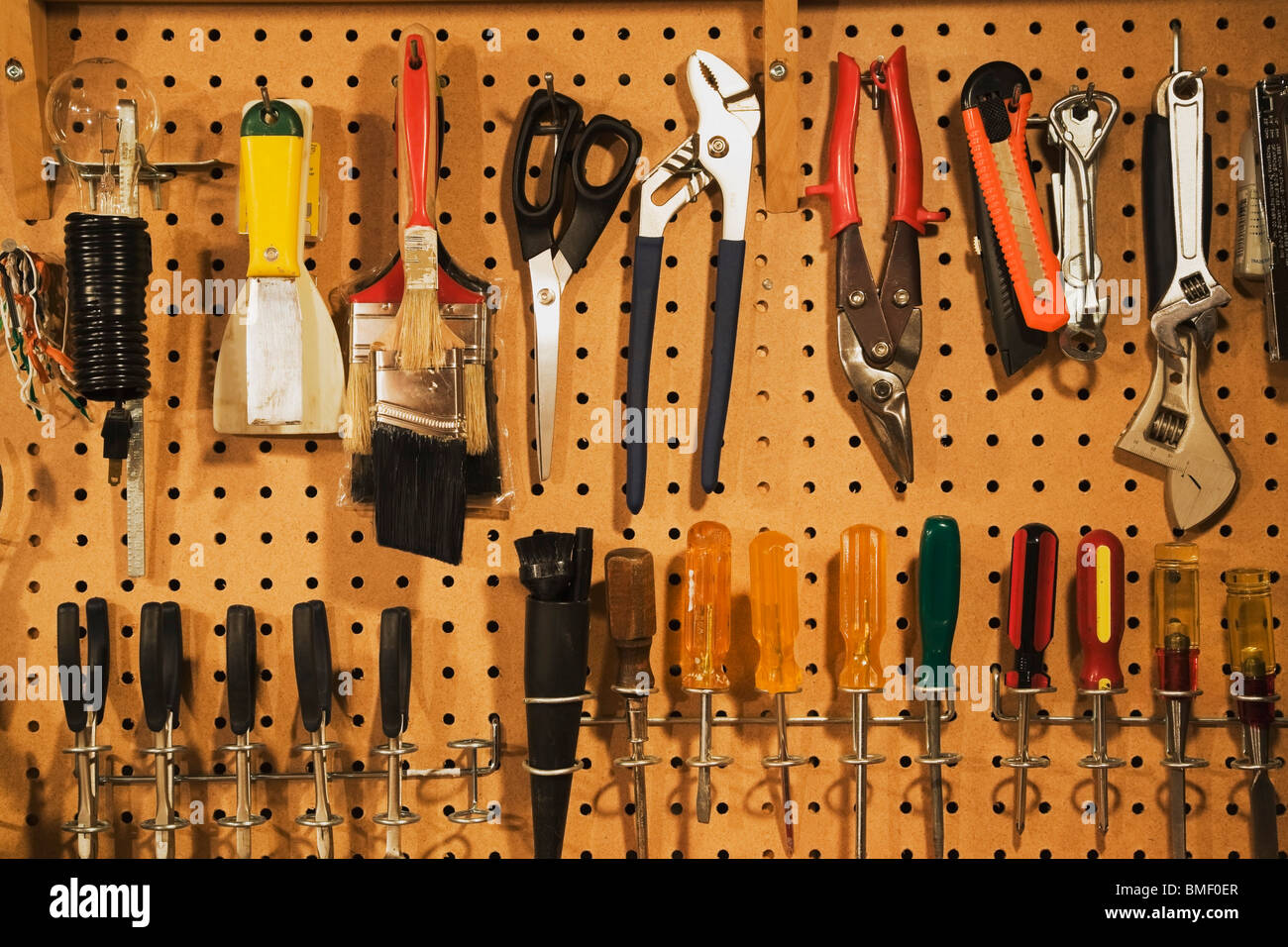 Assorted Workshop Tools On A Pegboard - Stock Image