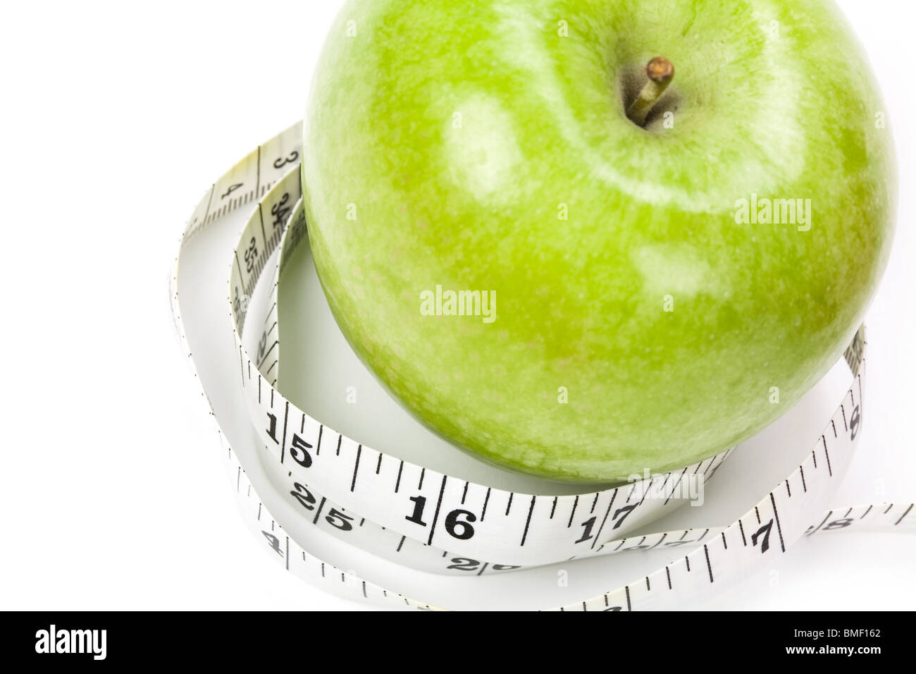 Green Apple with white background, close up shot - Stock Image