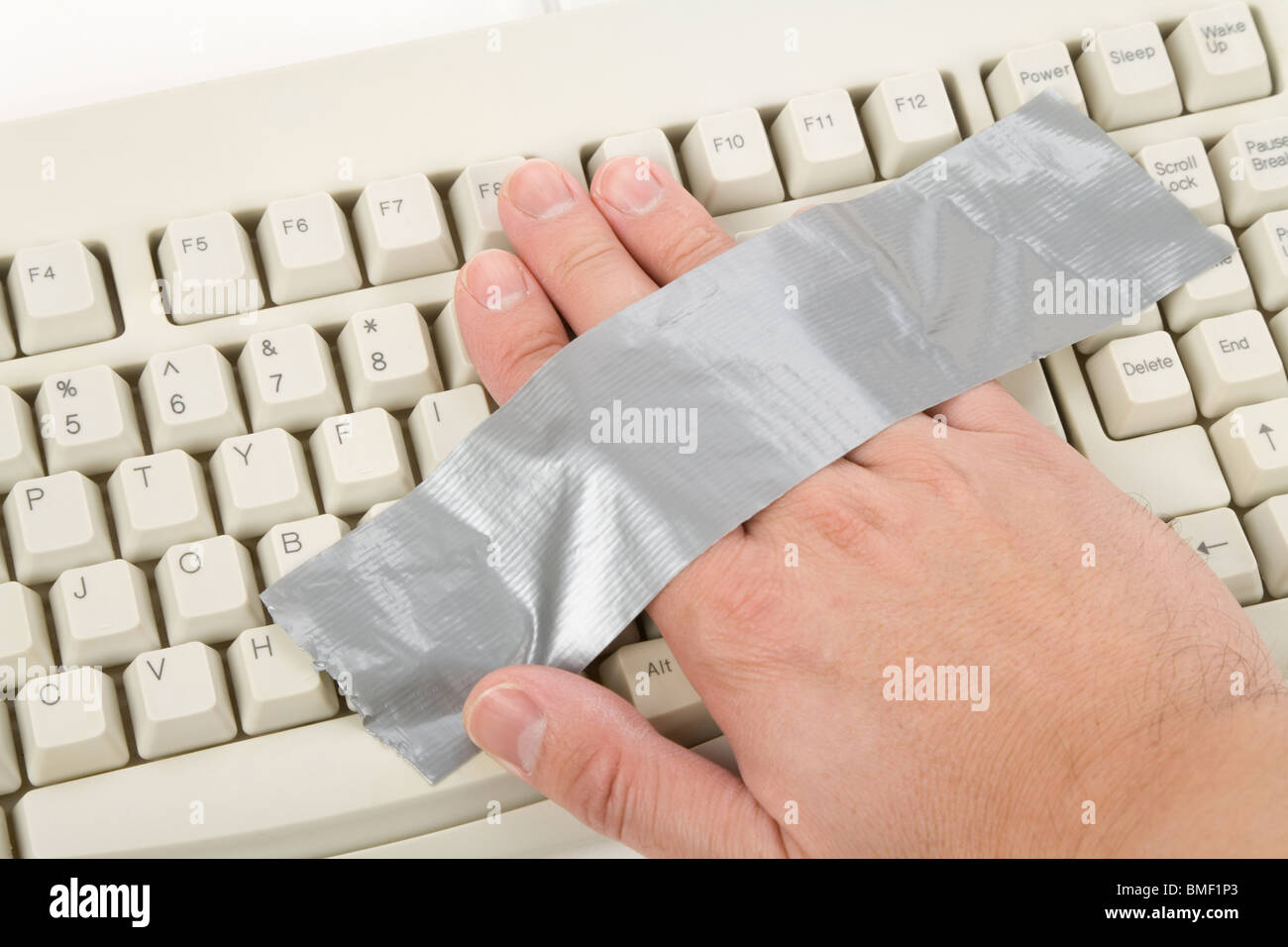 Hand had been stuck on Computer Keyboard - Stock Image