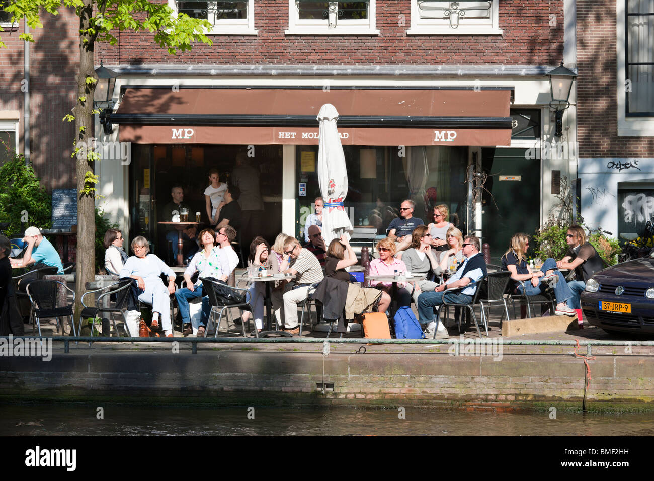 Amsterdam 'bar serving food' Het Molenpad. Outside sidewalk cafe terrace on the Prinsengracht Canal near - Stock Image
