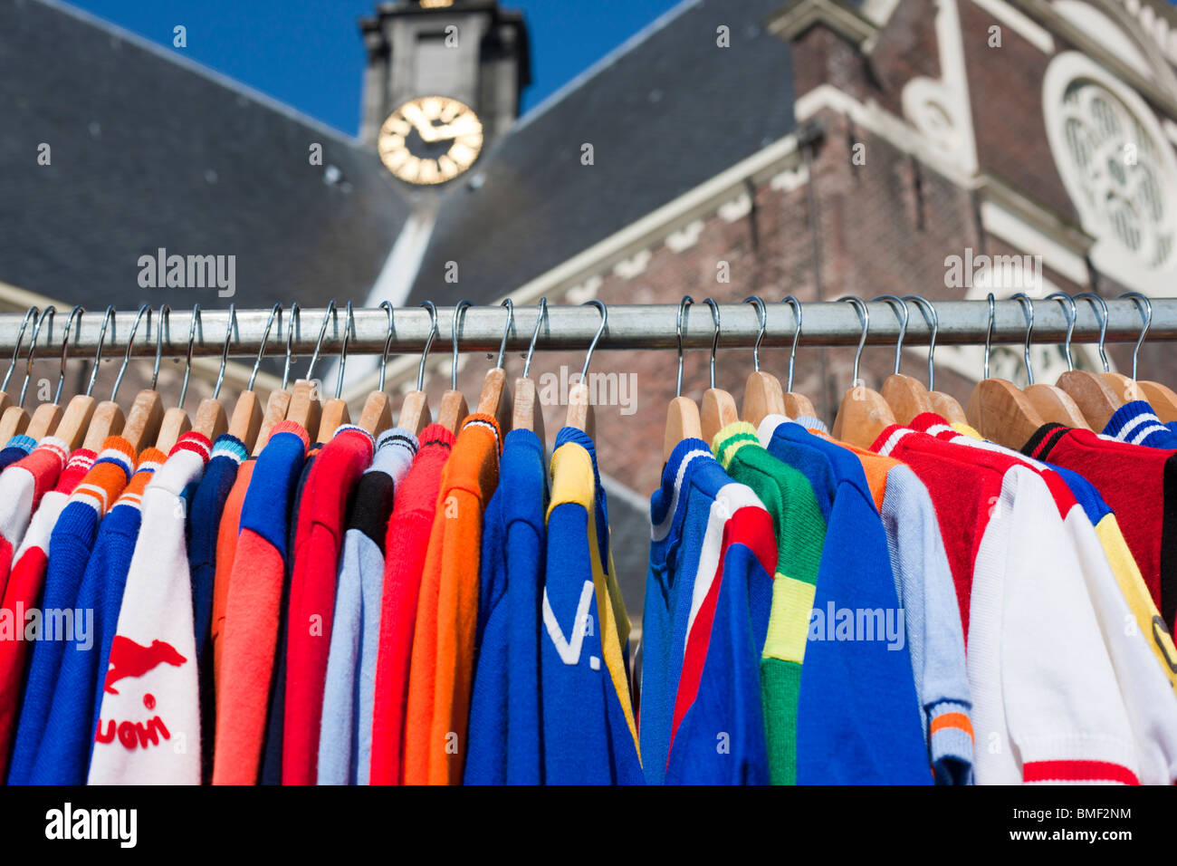 Vintage cycling jerseys for sale at the Noordermarkt, Northern Market, antiques and flea market on Monday morning - Stock Image