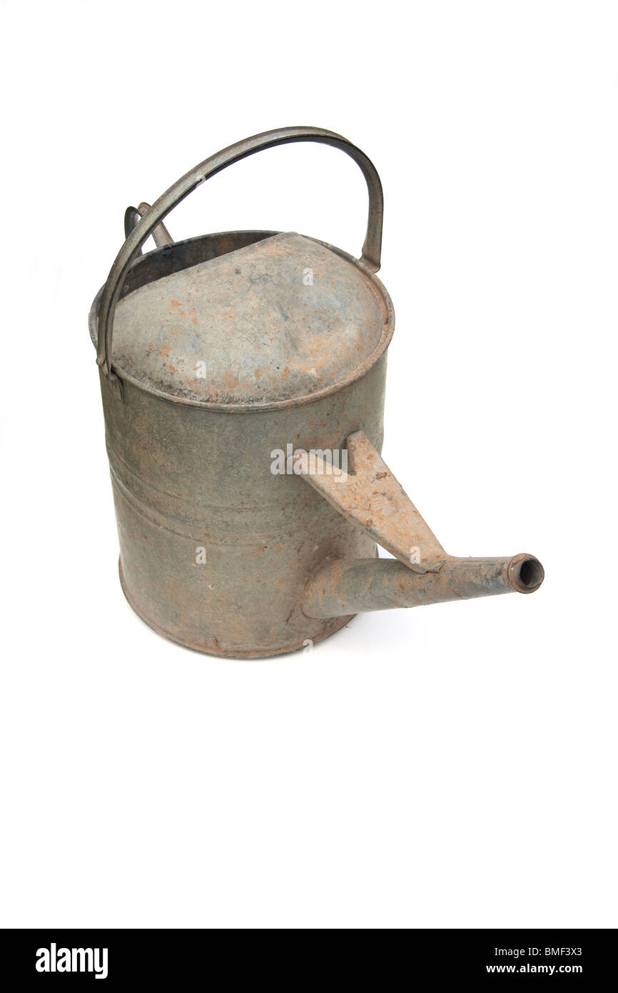 Traditional galvanized steel watering can isolated on a white studio background. - Stock Image