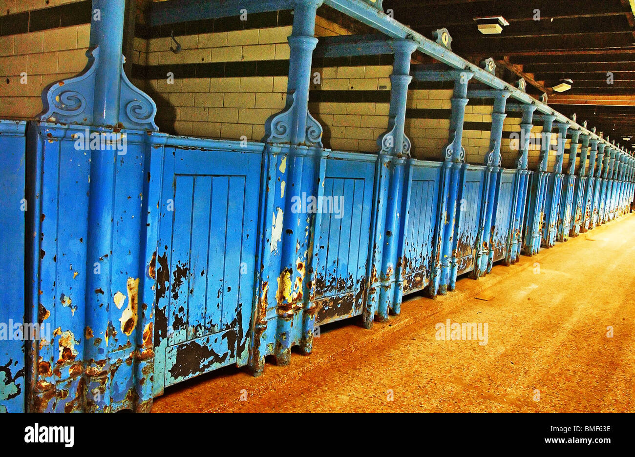 Line of changing cubicles at Victoria Baths in Hathersage Rd., Manchester, UK. - Stock Image