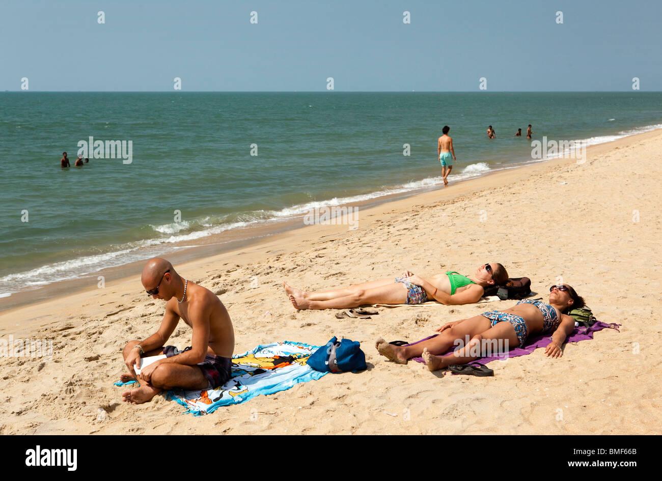 India, Kerala, Vypeen Island, Cherai Beach western sunbather - Stock Image