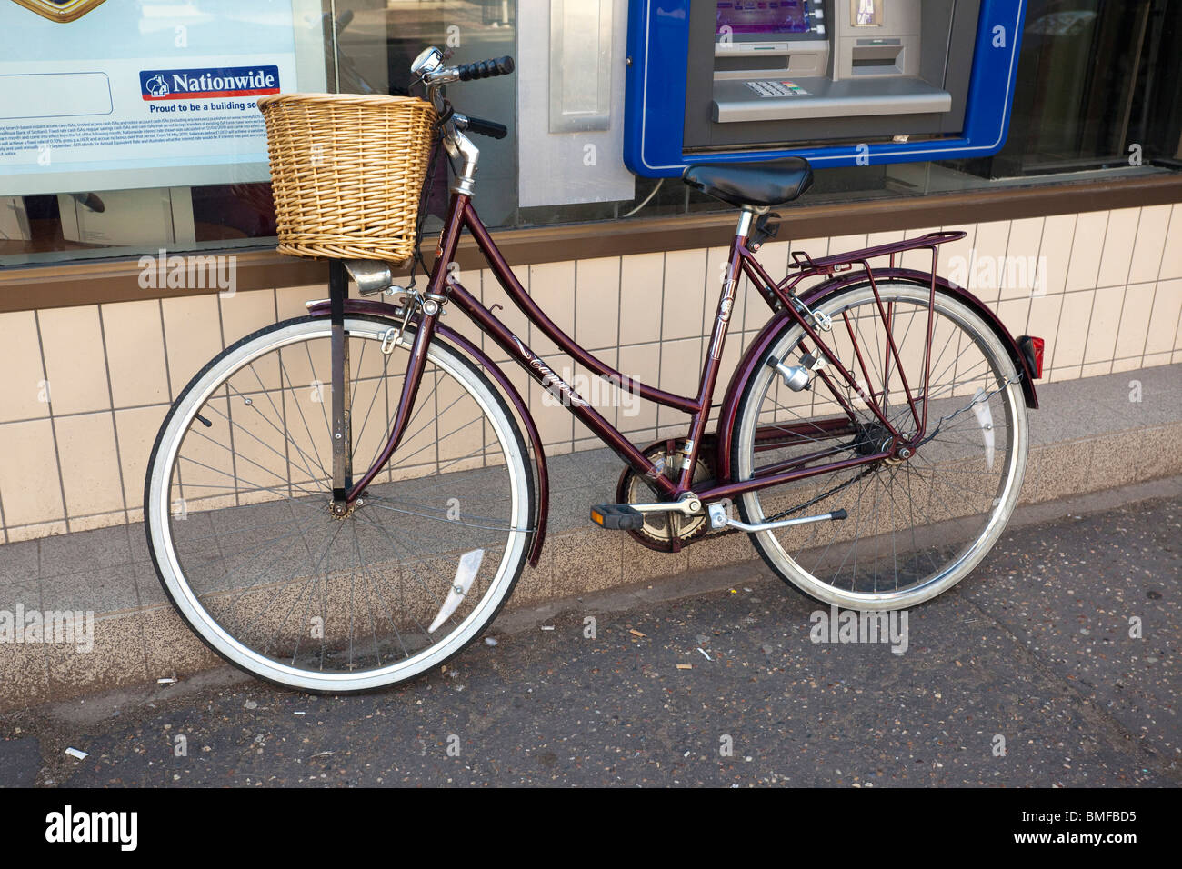bicycle parked on pavement - Stock Image