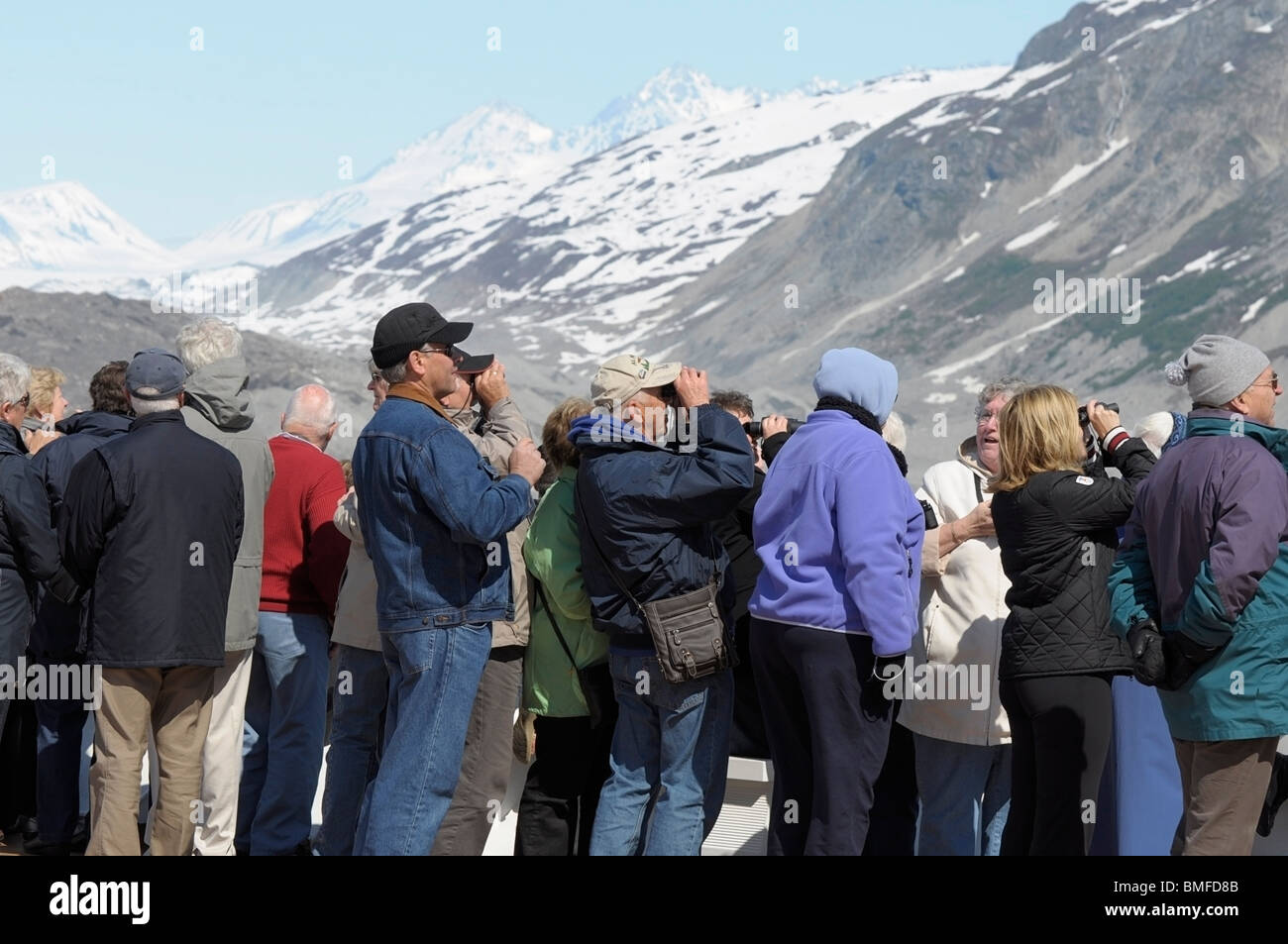 Tourists aboard a cruise ship looking at Glaciers, Glacier Bay, Alaska. - Stock Image
