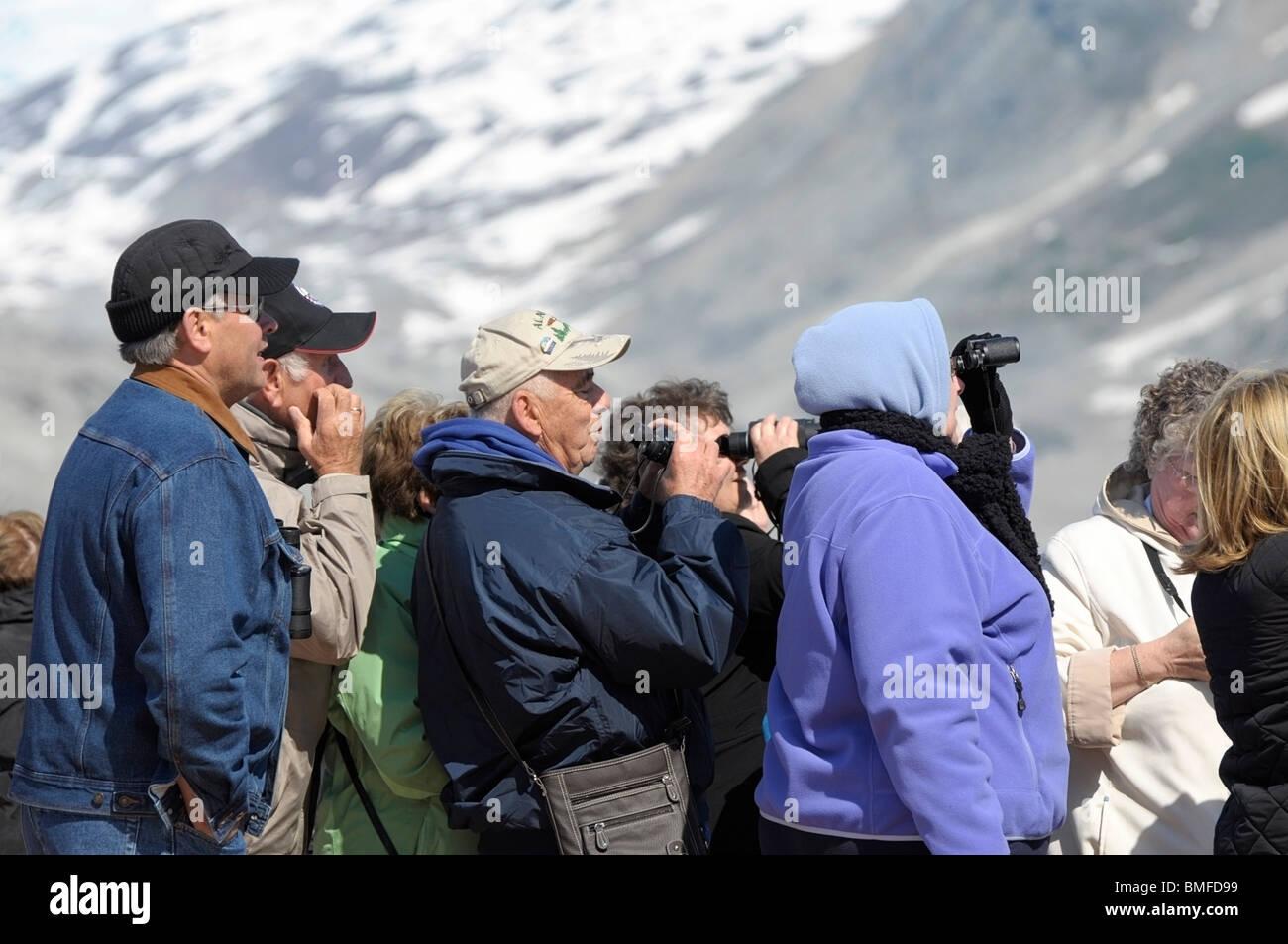Tourists aboard a cruise ship looking at Glaciers, Glacier Bay, Alaska. - Stock Image