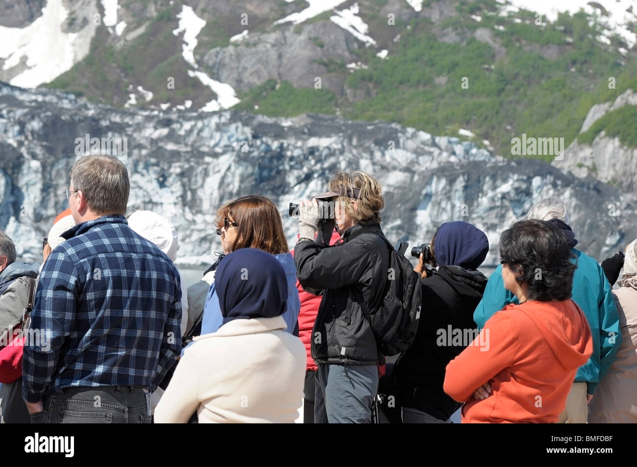 People aboard a cruise ship, looking at Glaciers and taking pictures.  Glacier Bay, Alaska. - Stock Image