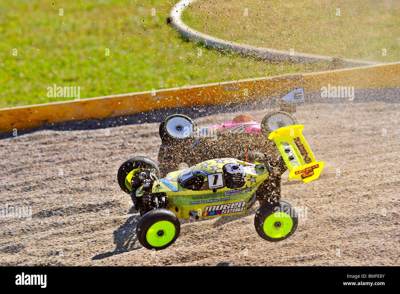 Crash. Two radio-controlled buggies collide as they race, dirt flying - Stock Image