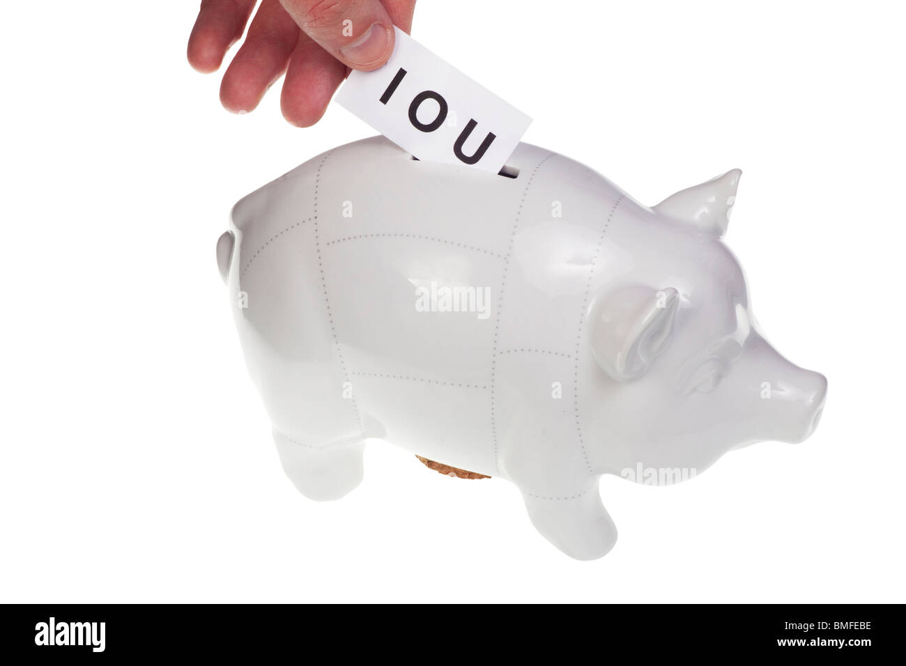 hand dropping IOU note in piggy bank - dept - Stock Image