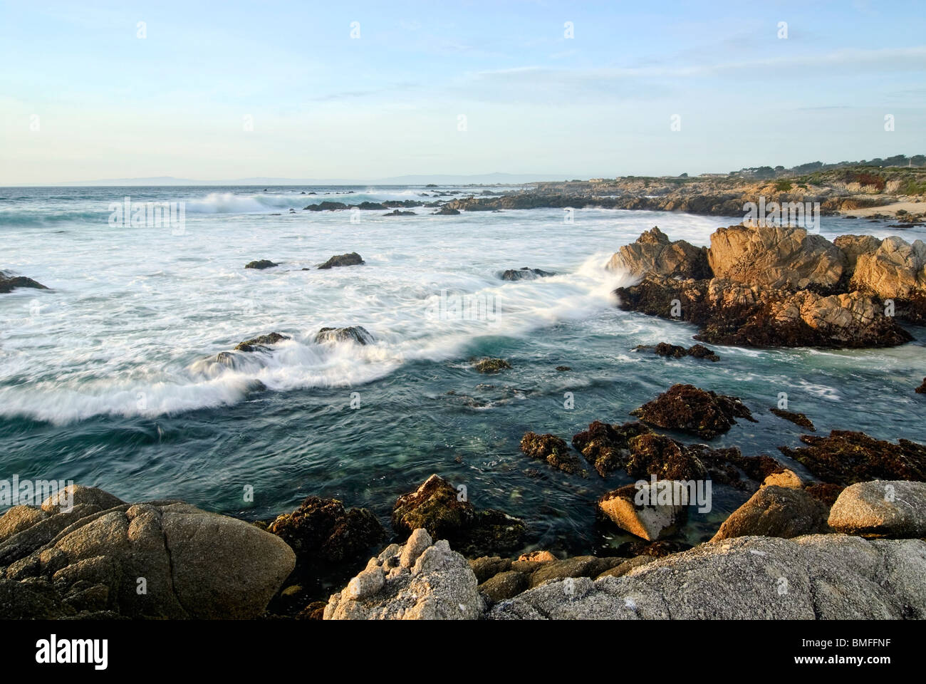 Gentle waves on rocky Asilomar Beach. Located on the Monterey Peninsula in the city of Pacific Grove. - Stock Image