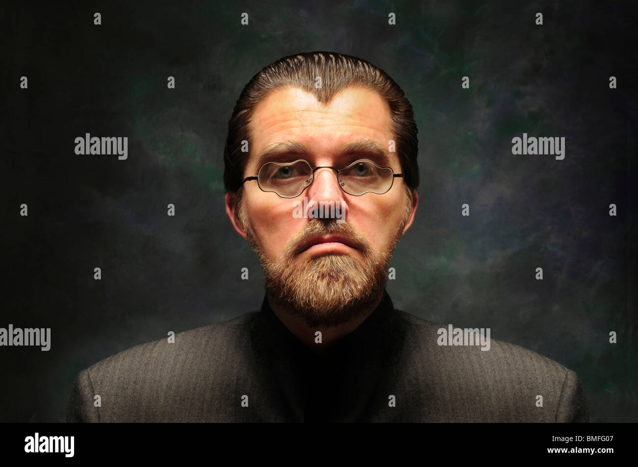 Orwellian character with distorted misshapen glasses and beard against a dark background Stock Photo