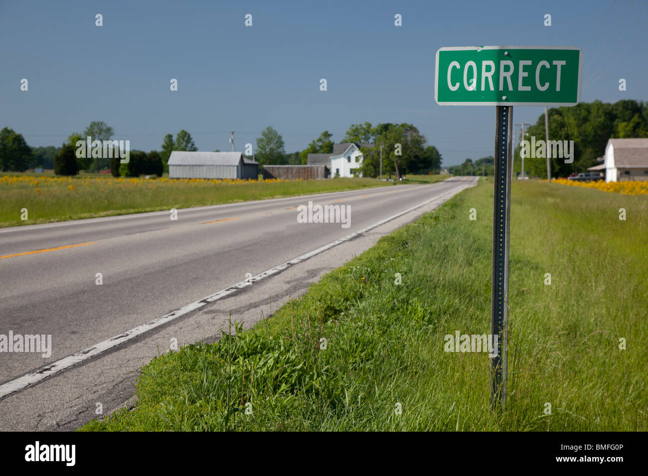 Correct, Indiana - A road sign tells drivers they are arriving in the small town of Correct. - Stock Image