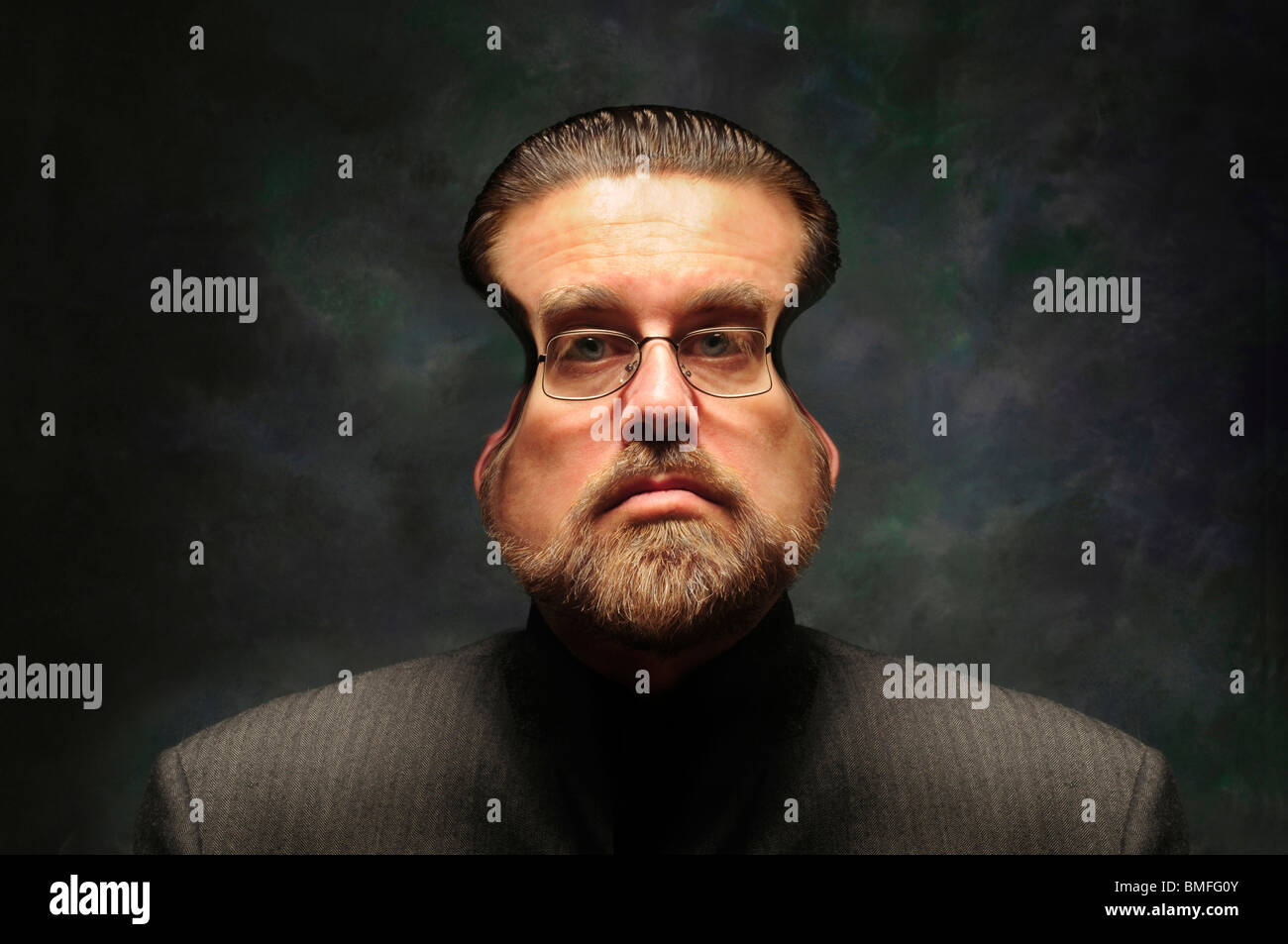Man with squeezed face distorted with glasses and beard - Stock Image