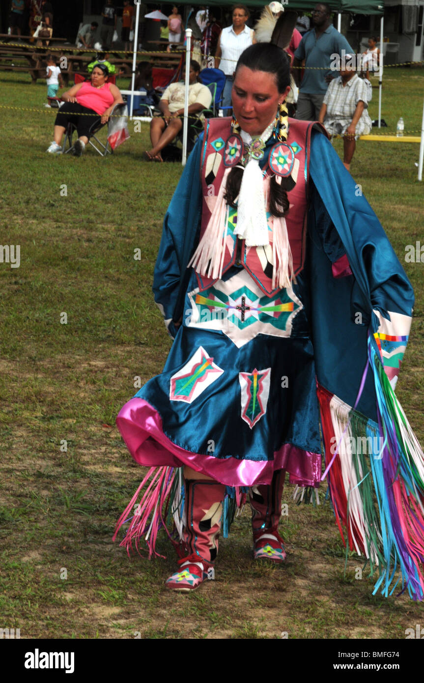 Native American woman wearing traditional clothes dance at ...