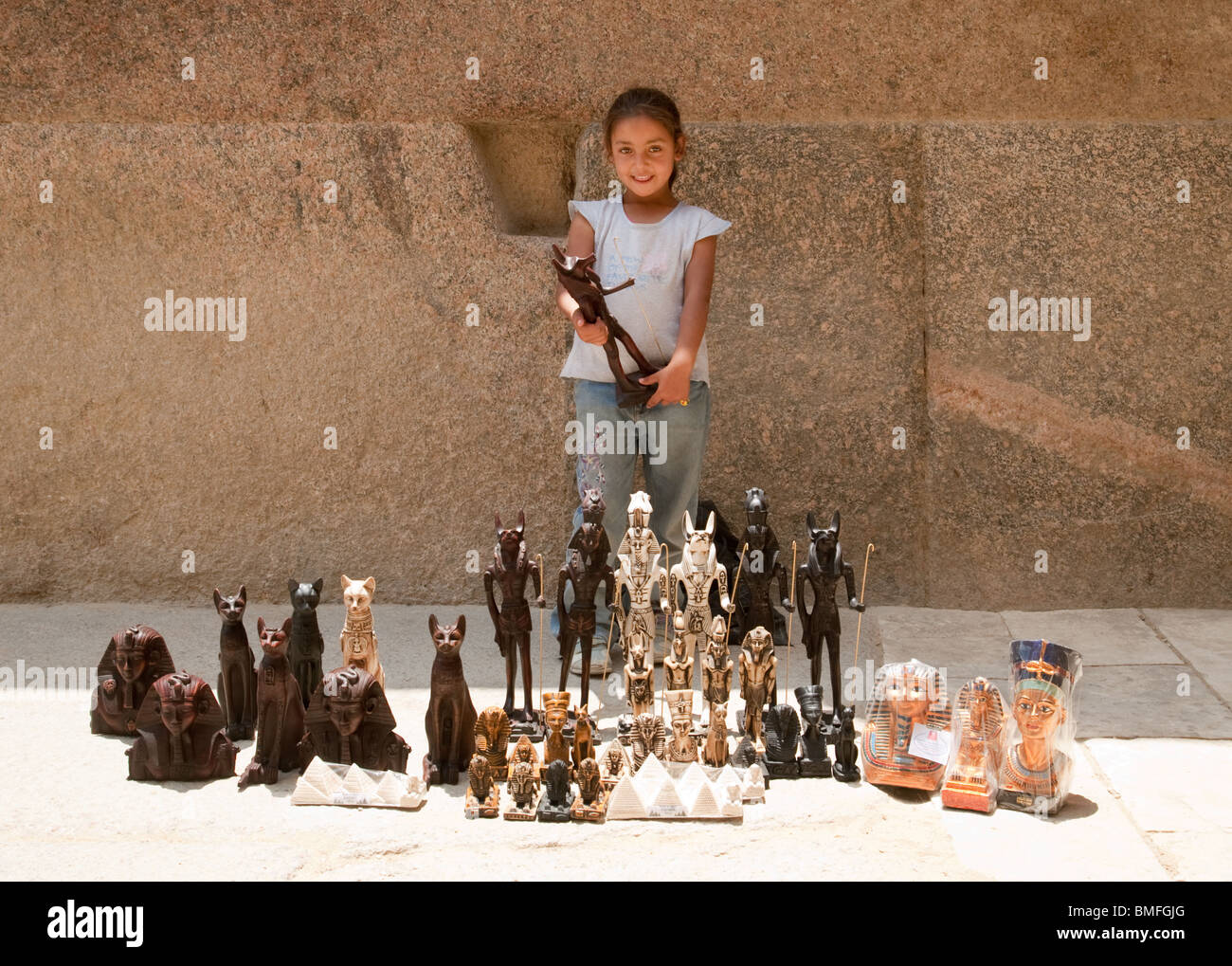 A  young Egyptian muslim girl selling tourist souvenirs, Giza, Cairo, Egypt - Stock Image