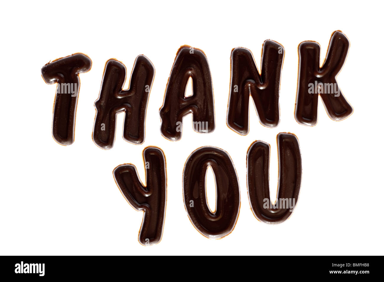 Big chocolate lettering thank you - Stock Image