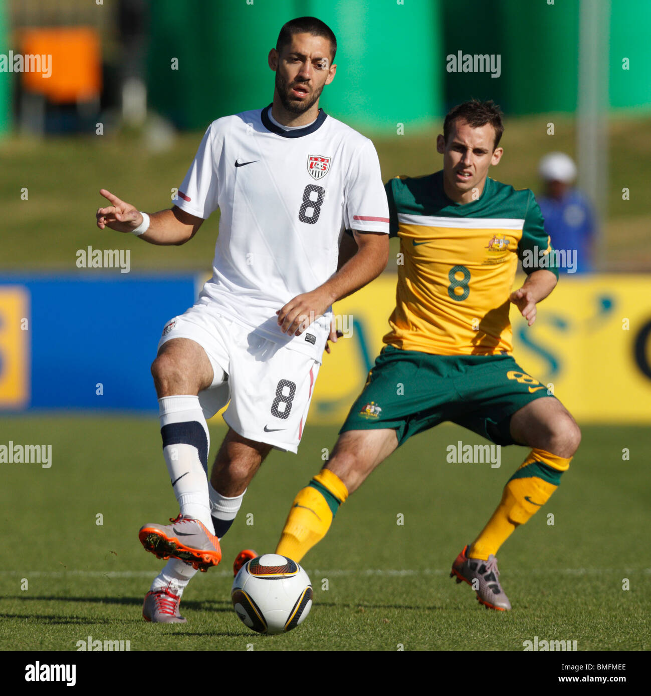 Clint Dempsey of the USA passes the ball against Luke Wilkshire of Australia  during a friendly ahead of the 2010 - Stock Image