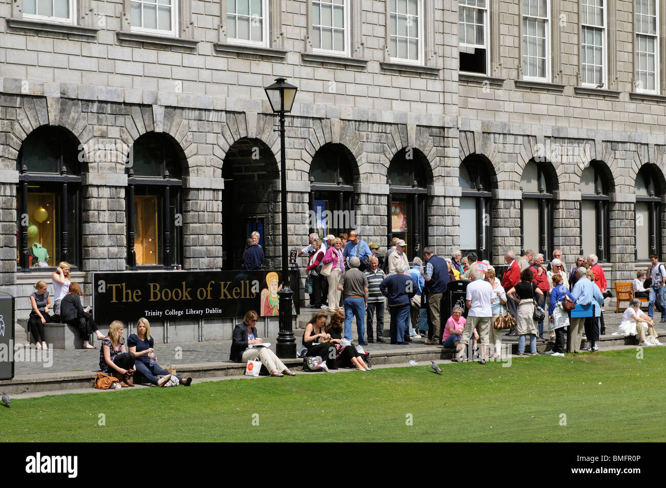 Fellows Square and Trinity College Dublin Ireland The Library entrance and Book of Kells exhibition - Stock Image