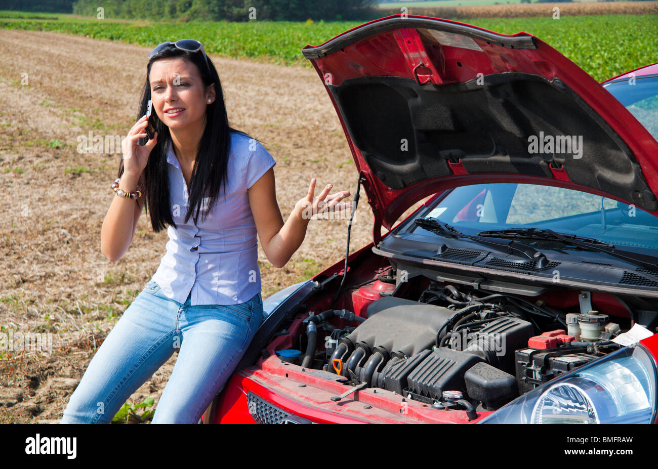 Young woman with her car breakdown. Engine failure Stock Photo ...