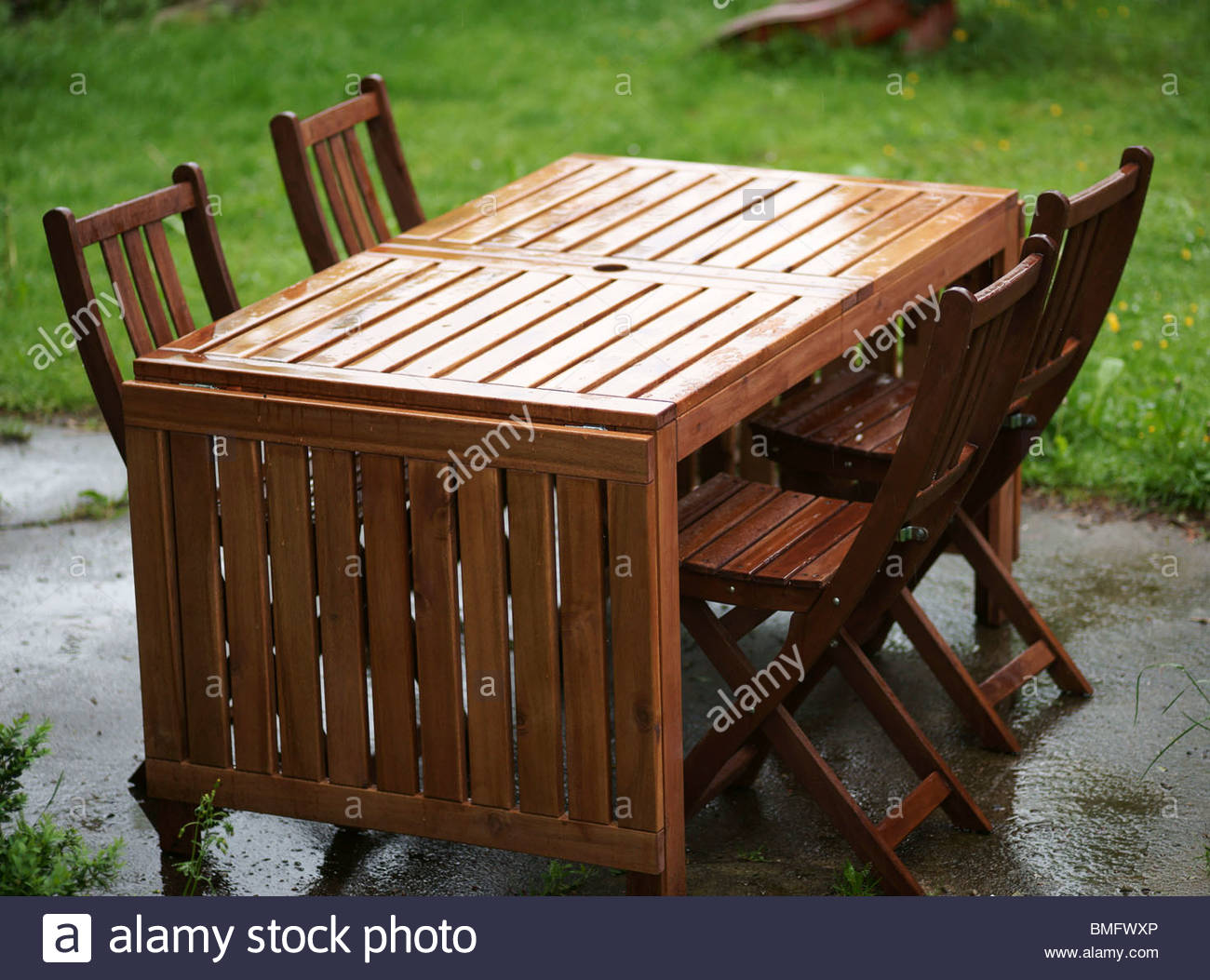 Garden furniture wooden table and chairs Stock Photo - Alamy