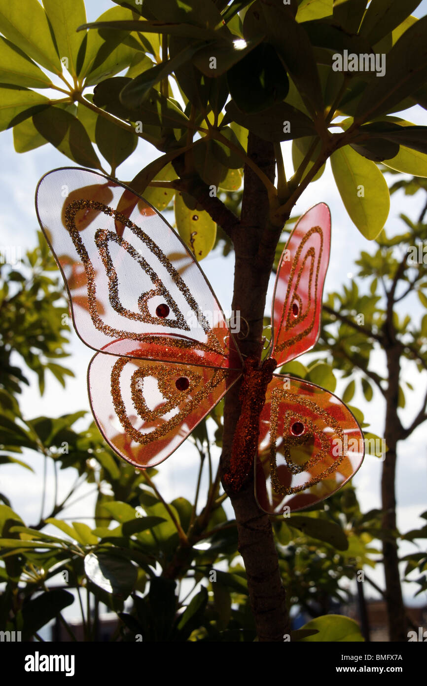 Plastic Butterfly On Tree Branches In Garden   Stock Image