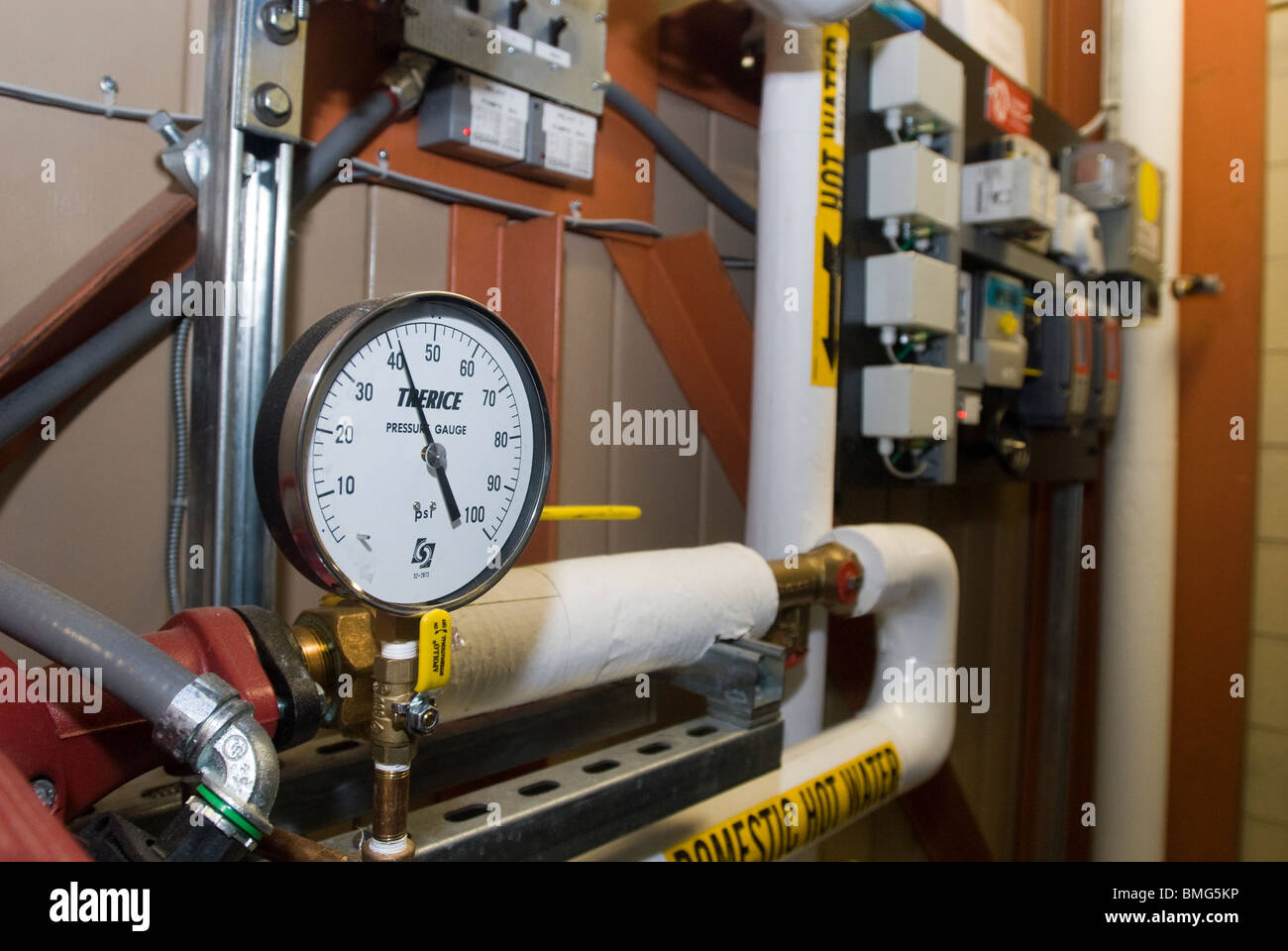 Hot water pressure gauge and control system for the solar thermal system at the Coney Island Train Yard Maintenance - Stock Image