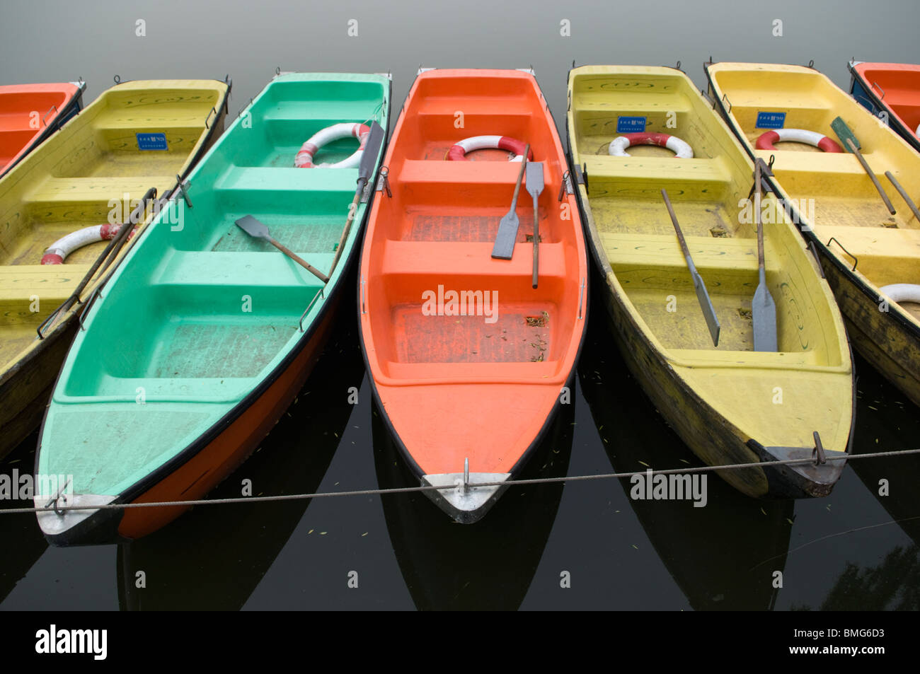 Colourful rowboats in Beihai Park Beijing China Stock Photo