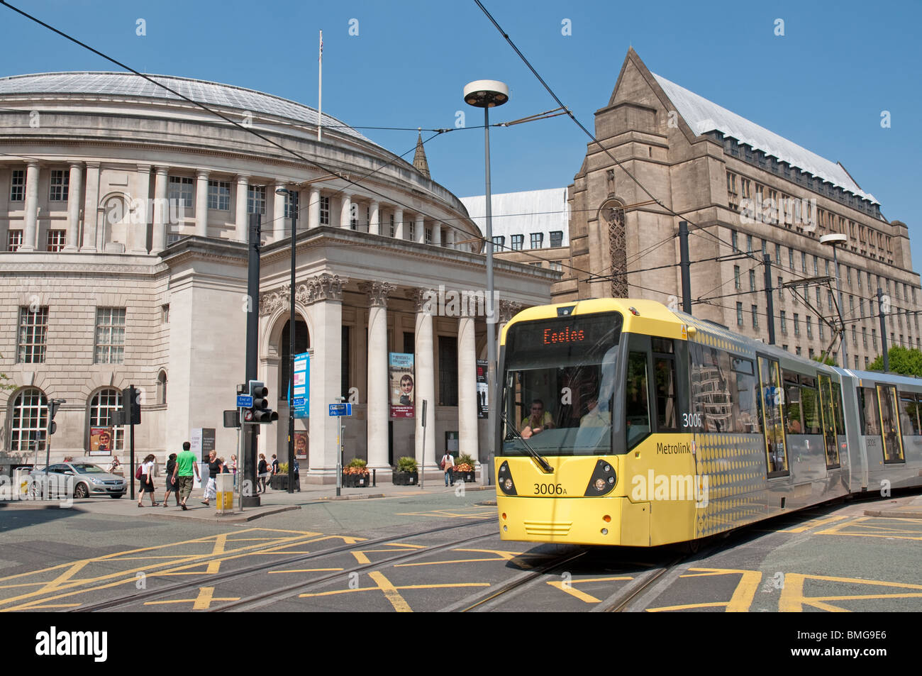 Tram in St Peters SquareManchesterCentral Library and the Town
