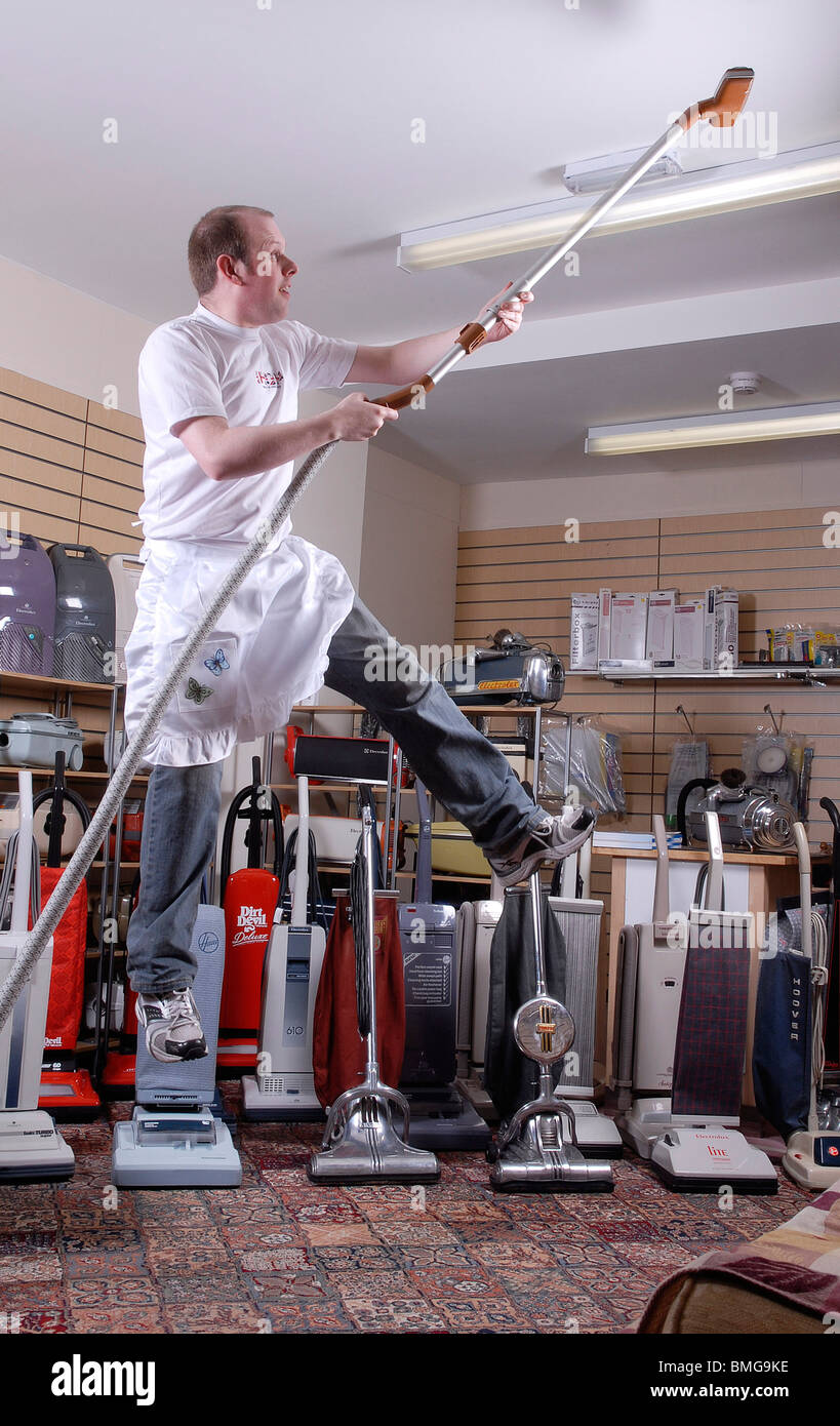 Dancing on the ceiling.... James Brown, curator of Britain's only museum of vacuum cleaners at Eastwood, Nr. - Stock Image