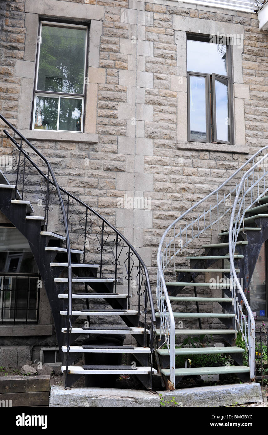 Symmetrical spiral staircases in Latin Quarter of Old Montreal. - Stock Image