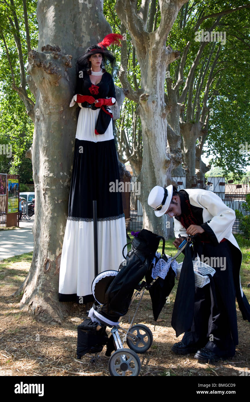 Comedians on stilts during the gardens day Stock Photo