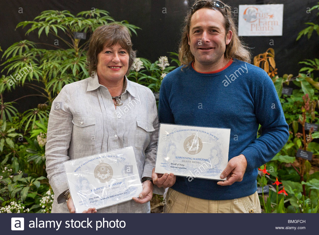 Sue Wynn Jones of Crug Farm Plants and Ben Kettle from World of Ferns N Wales at Gardening Scotland 2010 - Stock Image