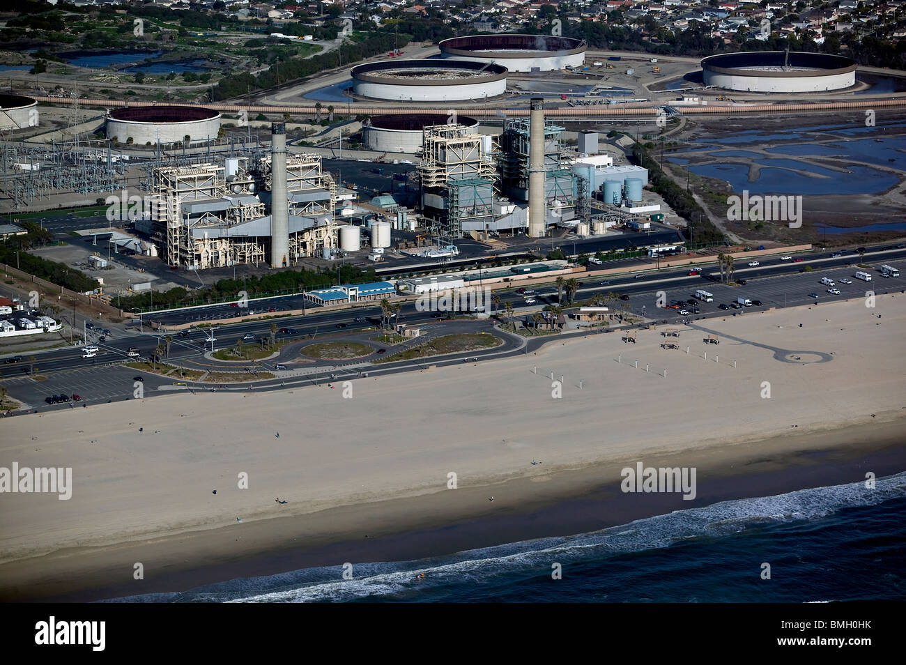 aerial view above AES Power Plant electrical generating gas fired steam plant Huntington Beach California - Stock Image