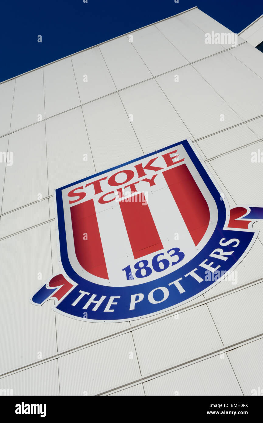 Stoke City FC badge, The Potters, on the side of the Britannia Stadium set against a clear blue sky - Stock Image