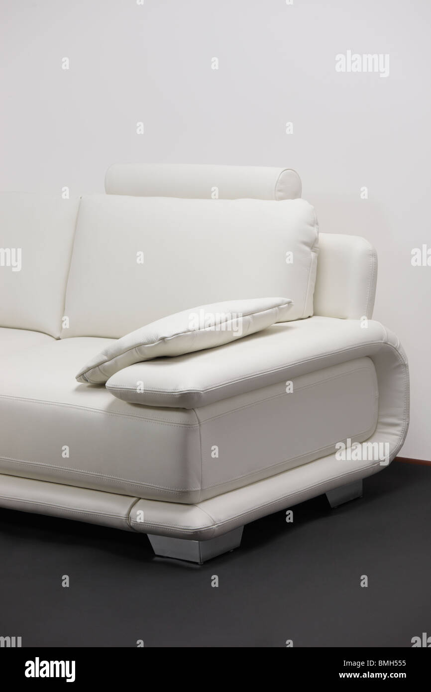 A detail of white leather sofa - Stock Image