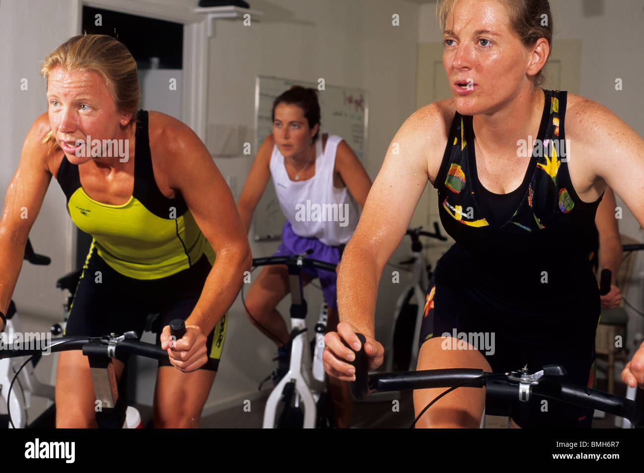People in a spinning class at the gym. Stock Photo
