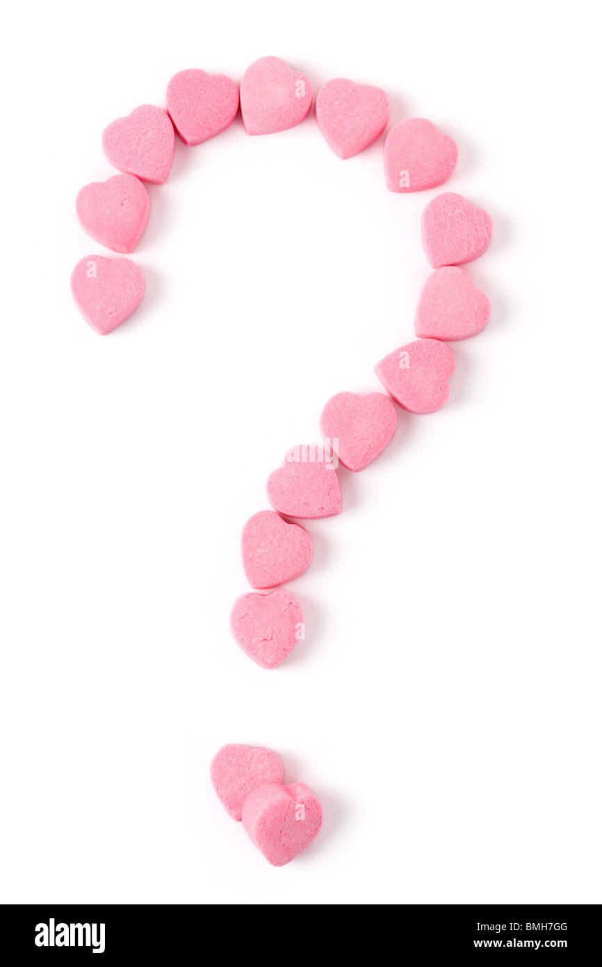 Pink Heart Shape Candy and Question Mark, Love Puzzle - Stock Image