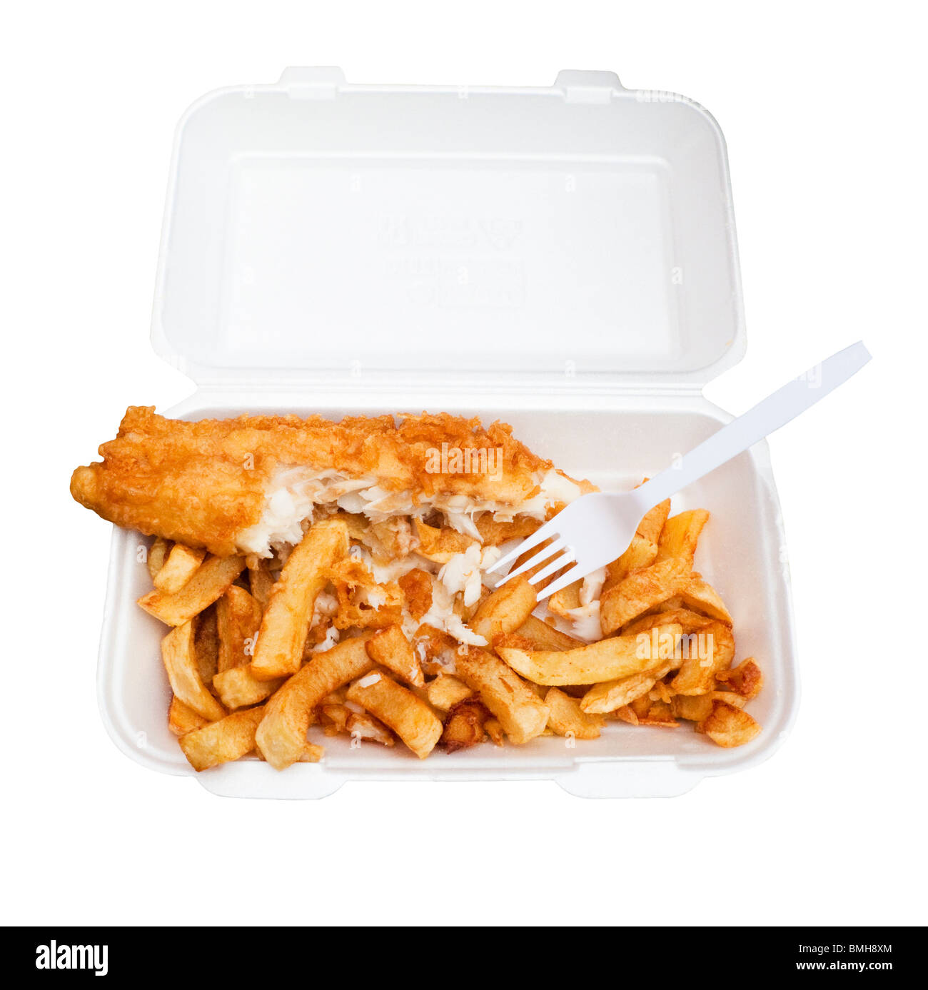 Fish and Chips in a plastic takeaway container half eaten - on white background - Stock Image