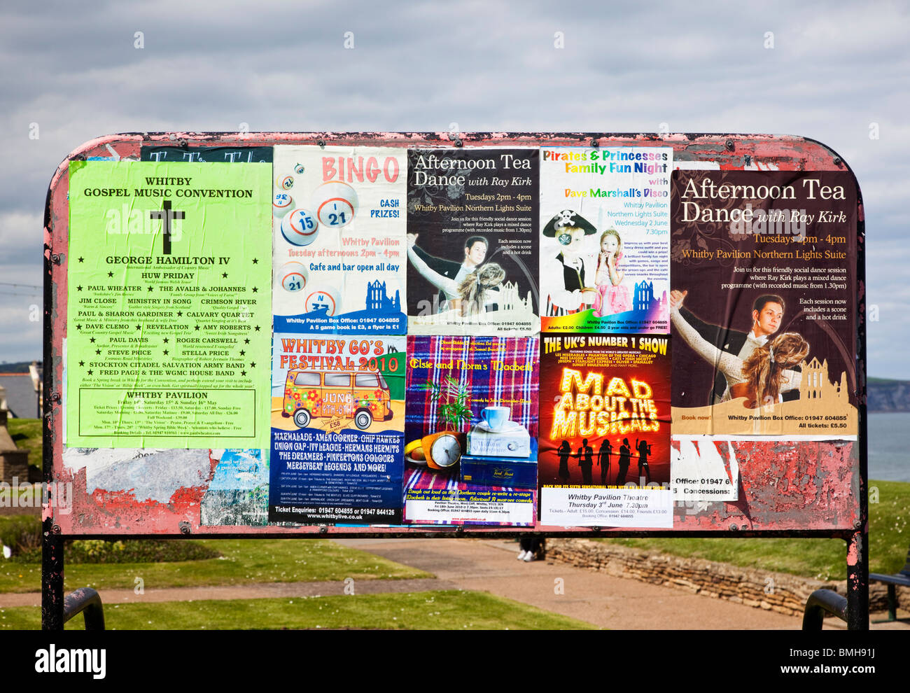 Noticeboard with local event and community activities posters in England, UK - Stock Image