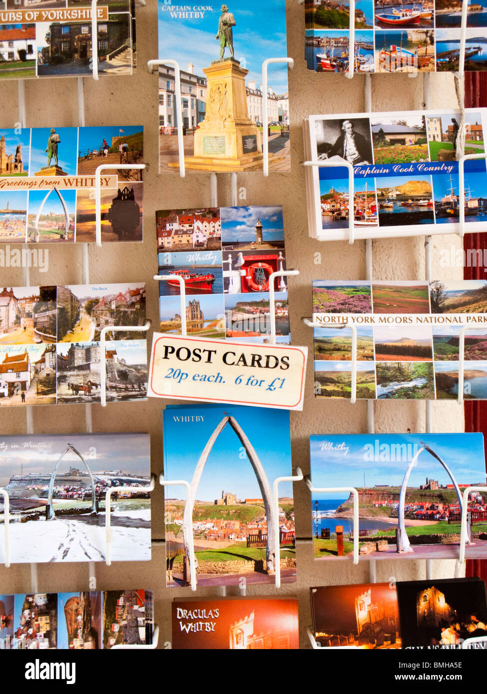 Postcards on a rack, Whitby, UK - Stock Image