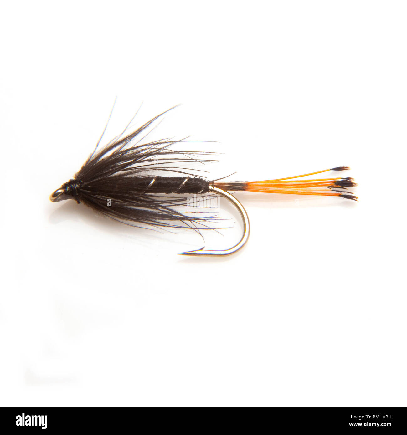 Black pennell trout fishing fly isolated on a white studio background. Stock Photo