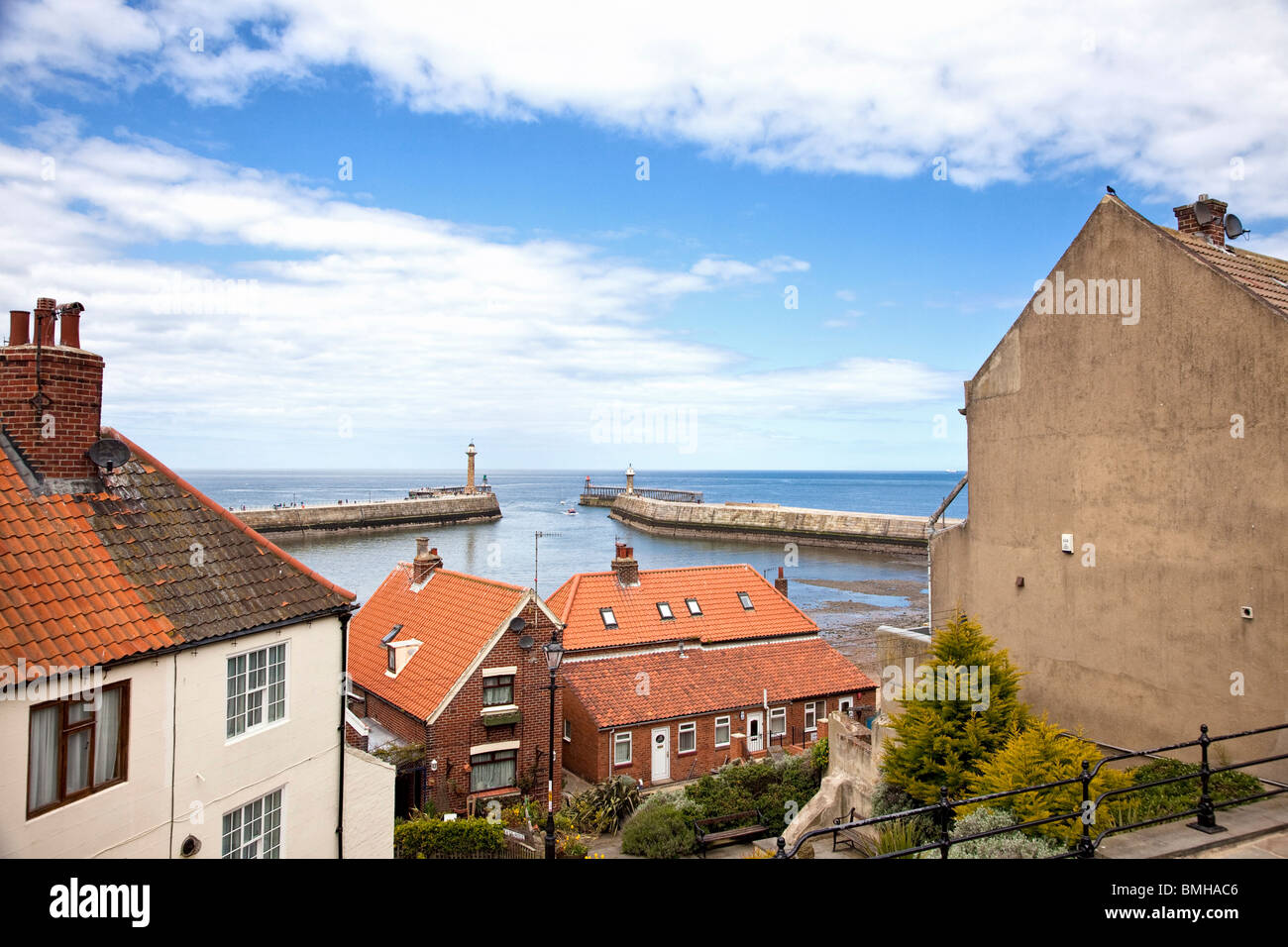 Whitby's two piers and Whitby harbour entrance North Yorkshire England UK - Stock Image