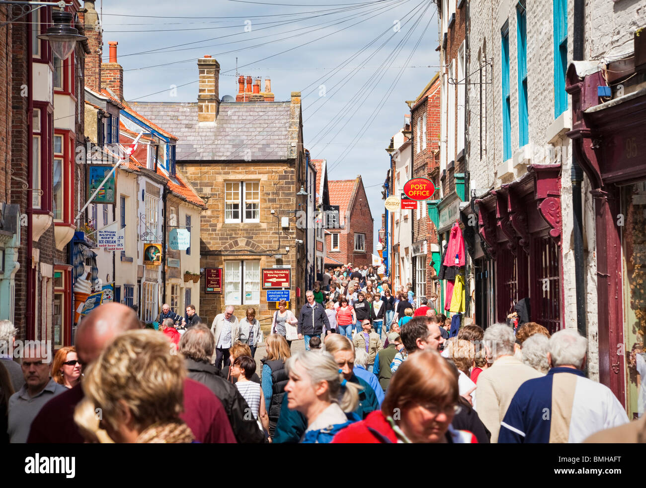 Crowded busy high street with shoppers in Whitby town centre, England, UK - Stock Image