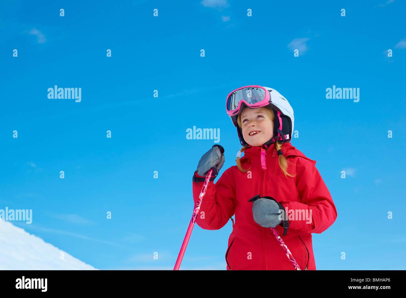 Girl skiing, blue sky - Stock Image