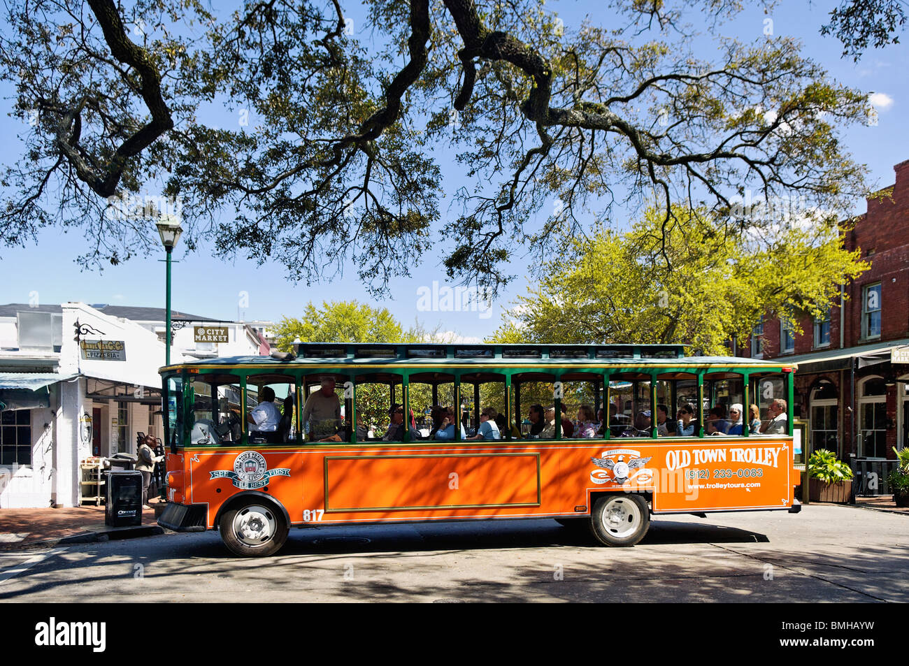 Old Town Trolley filled with Tourists in Downtown Savannah, Georgia - Stock Image
