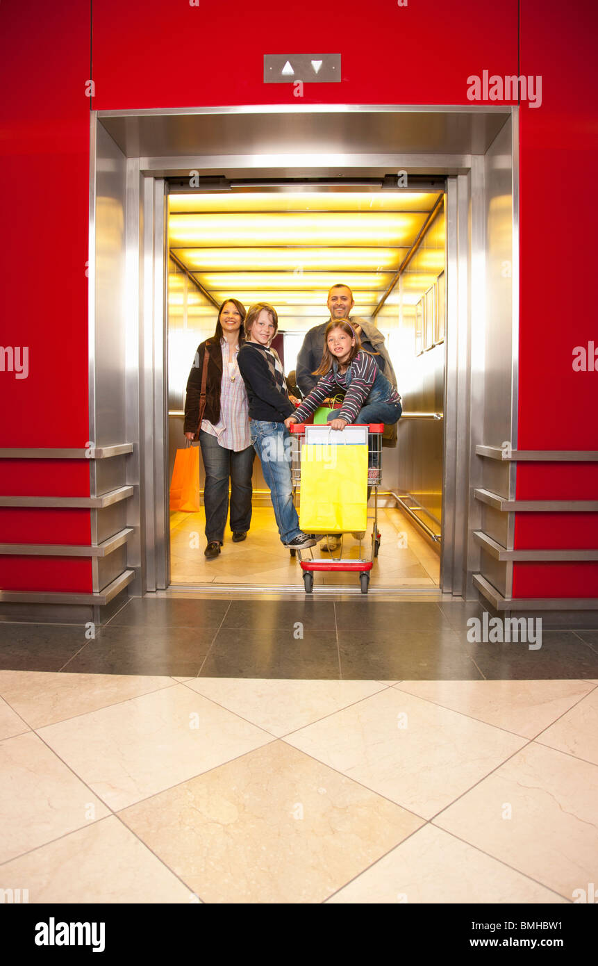 Family coming out of an elevator - Stock Image