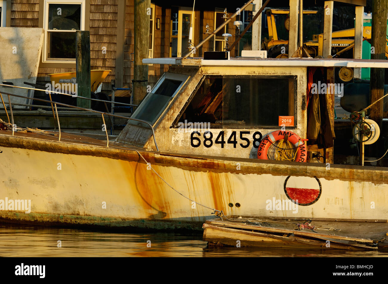 Evening Light on Old Fishing Boat on Shem Creek in Charleston County, South Carolina - Stock Image