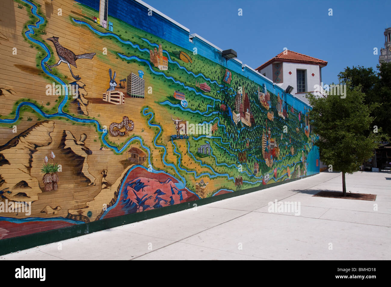 Colorful mural in Renaissance Market plaza along the drag at the University of Texas at Austin - Stock Image