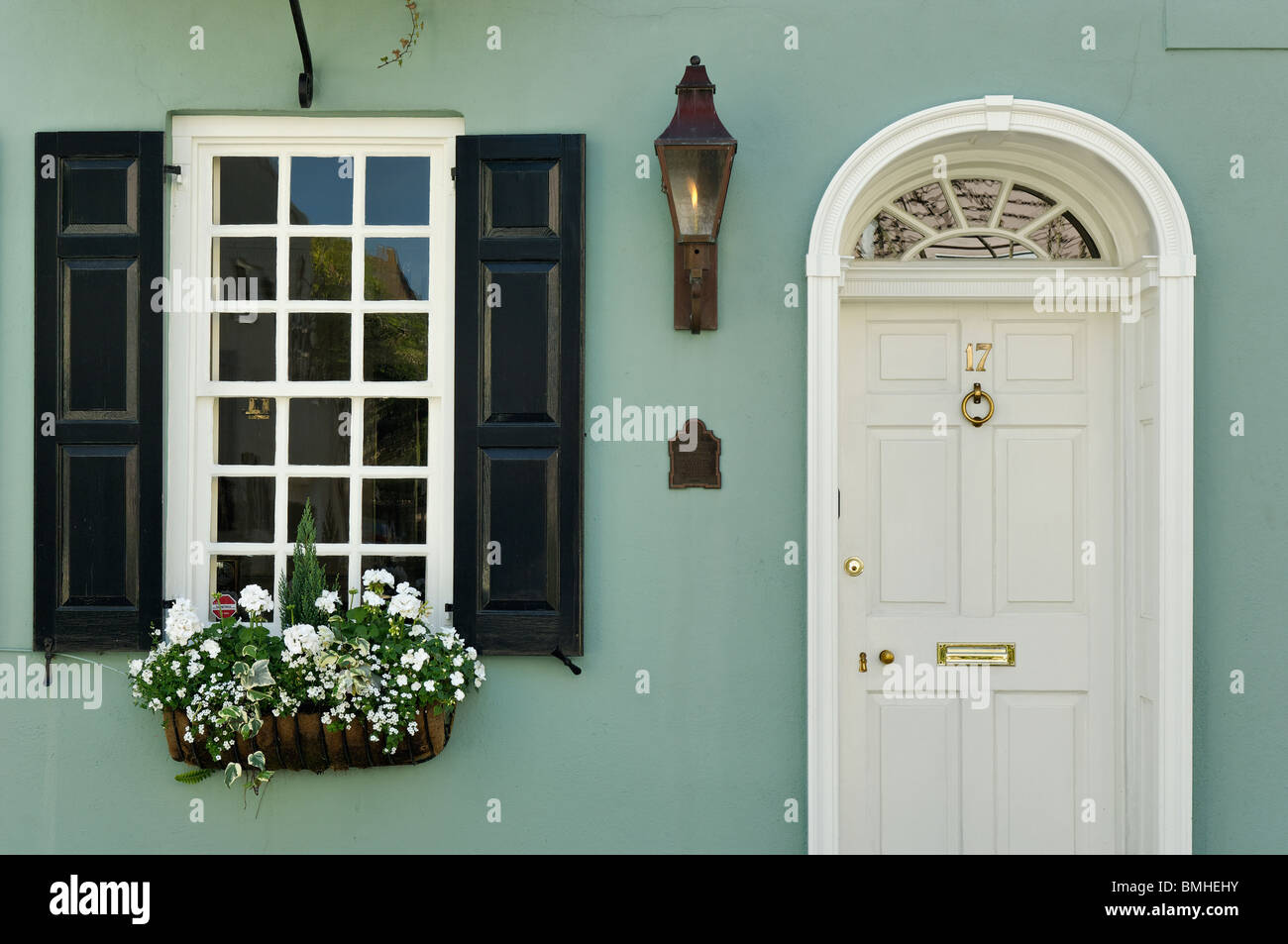 Detail of Door and Window of the Historic Charles Warham Home in Charleston, South Carolina - Stock Image
